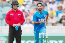 Umpire John Ward officiates under a helmet during India-Australia ODI