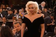 The award for the best reaction goes to Leonardo Di Caprio on Lady Gaga's win
