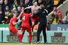 Lallana's injury-time winner helps Liverpool sink Norwich 5-4 in EPL