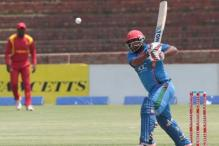 Mohammad Shahzad hits fourth highest T20 score as Afghanistan rout Zimbabwe