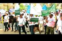 Supporters of 'Walk of Hope' participate in Mumbai marathon