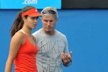 Ana Ivanovic's match suspended after her coach collapsed in stands