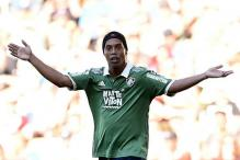 Close shave for Ronaldinho in India, a falling pole just misses his car