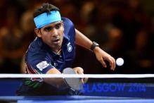 Setback for men, women advance at World Table Tennis Championships