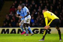 Late goals from Yaya Toure, Sergio Aguero help Manchester City win 2-1 at Watford