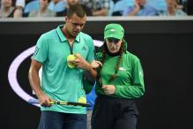 Australian Open: Tsonga rescues ailing ball girl, wins accolades