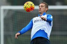 Ex-Man United skipper Vidic hangs up boots, citing a spat of injuries