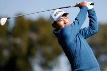 Golfer Sung sets Pebble Beach afire, takes lead after a superb 60