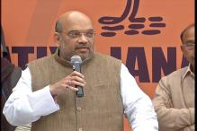 Amit Shah gives pep talk to BJP cadres in party 'lab', slams Rahul on JNU row