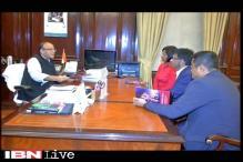 CNN-IBN team meets Arun Jaitley, presents him 'Axe the tax' document for Budget 2016