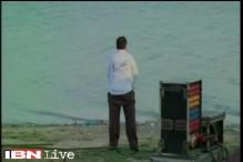 UP babu caught on cam peeing on banks of Triveni Sangam