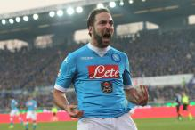 Serie A: Napoli stay top after game suspended for racist chanting