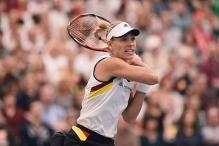 Kerber overcomes fatigue to win Fed Cup match for Germany