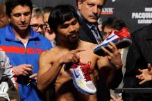 Nike drops boxer Pacquiao after he described gays as 'worse than animals'