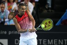 Nick Kyrgios plays through pain to reach Dubai semis