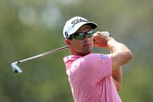 Adam Scott seizes halfway lead at World Golf Championships