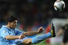 Suarez returns to Uruguay squad after serving biting ban