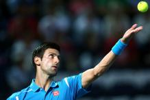 Murray, Djokovic wins set up Britain-Serbia Davis Cup clash