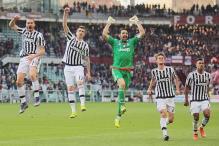Serie A: Juventus stretch unbeaten run on record day for Gianluigi Buffon
