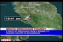 Suspected MH370 debris handed to Malaysian experts