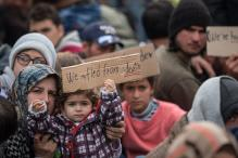 Greece vows to resolve migrant build-up on border within week