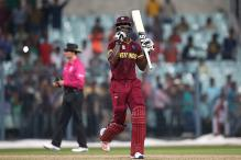 West Indies ride on Sammy's fifty to stun Australia in WT20 warm-up
