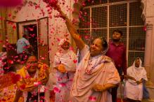 Vrindavan widows break tradition as they celebrate Holi for the first time at a temple