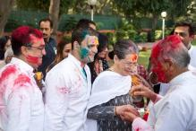 Delhi soaks in spirit of Holi; Sonia, Rahul, CM greet people
