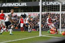 Late Sanchez strike earns 10-man Arsenal a 2-2 draw at Spurs