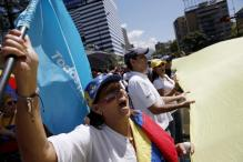 Venezuelans hold rival marches for and against government