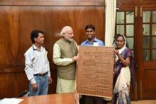 Carpenter gifts Gita carved in wood to Narendra Modi