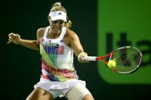 Defending champion Kerber opens her Charleston campaign with a win