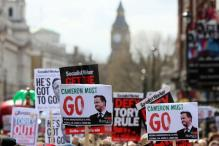 Thousands march in London demanding Cameron resignation