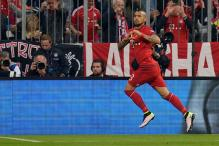 Bayern edge resolute Benfica with early Vidal goal in Champions League