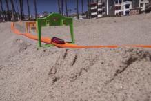 Watch: This Toy Car Track on the Beach Will Set Your Pulse Racing