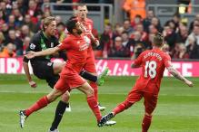 Liverpool romp to 4-1 victory over Stoke