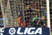 Four-Goal Suarez Keeps Barcelona on top in La Liga