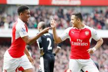 Arsenal keep title hopes alive with a 4-0 win over Watford