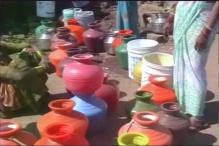 People lock stored water as Mumbai faces acute water shortage