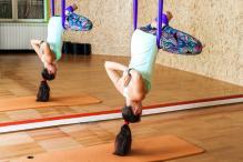 Beer, Weights, Hammocks: Unusual New Trends in Yoga