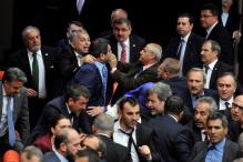 Turkish Lawmakers Exchange Punches, Hurl Bottles in Parliament