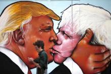 Pro-EU Group Unveils Soviet-Style Mural of Trump Kissing Ex-Mayor Johnson
