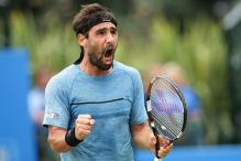 Marcos Baghdatis Advances After Saving 2 Match Points in Nottingham