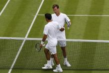 Berdych Battles to Four-set Win at Rain-hit Wimbledon
