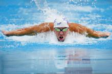 Michael Phelps Wins 100m Free, Falters in Fly in Austin