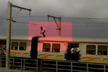 Watch Dare Devil Stunt on Top of Moving Mumbai Local