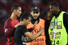 Cristiano Ronaldo Joins Pitch Invader for Selfie