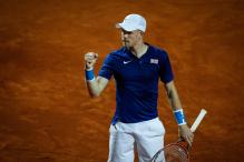 Edmund Puts Britain Ahead Over Serbia in Rain-Hit Davis Cup