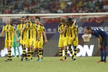 Mourinho's Manchester United Stunned 4-1 by Dortmund in China