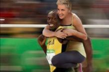 Ellen DeGeneres Accused Of Racism After Photoshopping Herself Riding Usain Bolt